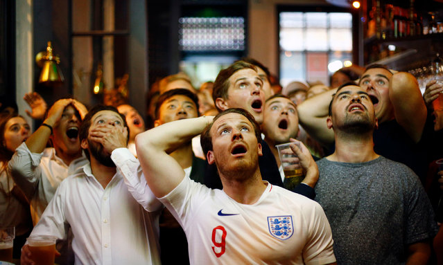 """The """"Assignments"""" exhibition is an annual chance to see the top images by UK photojournalists, as chosen by the British Press Photographers' Association. Here: England fans watch Croatia v England in Trafalgar Square on 11 July 2018. (Photo by Henry Nicholls/Reuters)"""