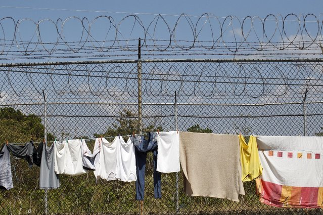 Clothes hang on the fence at La Joya prison on the outskirts of  Panama City, Panama February 5, 2016. (Photo by Carlos Jasso/Reuters)