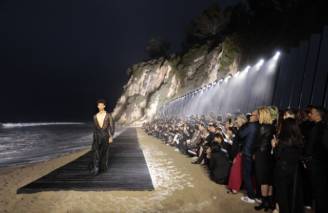 A model presents a creation during the Saint Laurent Men's Spring-Summer 2020 runway show in Malibu, California, on June 6, 2019. (Photo by Kyle Grillot/AFP Photo)