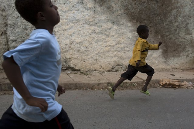 Boys run in the old walled town of Harar in eastern Ethiopia, May 19, 2015. (Photo by Siegfried Modola/Reuters)
