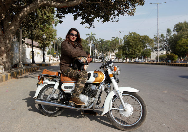 """Mehwish Ekhlaque, 26, a bike rider and trainer, poses for a photograph with her bike in Karachi, Pakistan, February 28, 2017. """"When I planned a Pakistan Bike Tour many of my male colleagues gave me a piece of advice not to do it as it's neither safe nor easy for a woman. But I did it"""", Ekhlaque said. (Photo by Akhtar Soomro/Reuters)"""