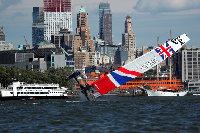 SailGP Team Great Britain skippered by Dylan Fletcher capsizes ahead of race one of day one of competition in the SailGP global sailboat racing series in New York harbor, New York, U.S., June 21, 2019. (Photo by Mike Segar/Reuters)
