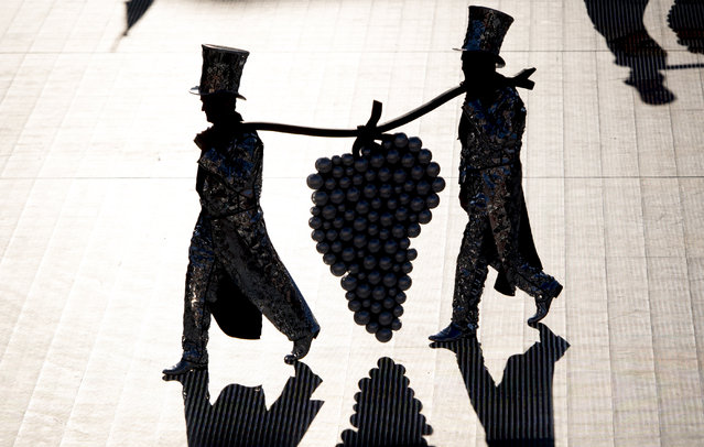 """Extras in the arena of the """"Fete des Vignerons"""" (winegrowers' festival in French), during the last rehearsal in Vevey, Switzerland, 17 July 2019. Organized by the brotherhood of winegrowers, the event will celebrate winemaking from 18 July to 11 August. The arena has a capacity of 20,000 spectators and hosts a giant central LED floor of approximately 800 square meters. (Photo by Laurent Gilliéron/EPA/EFE)"""