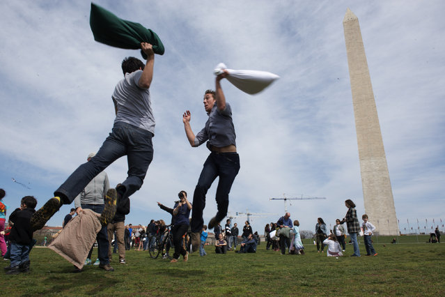 Alex Plunkett, left, and Sean Hart, both of Arlington, participate in International Pillow Fight Day on the Washington Monument grounds in the District, on April 6, 2014. (Photo by Marvin Joseph/The Washington Post)