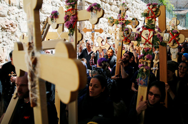 Orthodox Christian worshippers hold crosses before a procession along the Via Dolorosa on Good Friday during Holy Week in Jerusalem's Old City April 29, 2016. (Photo by Ammar Awad/Reuters)