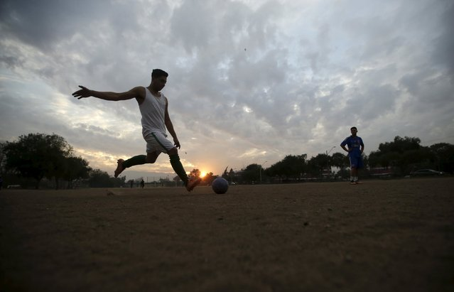 Youths play soccer in Santiago, Chile, July 1, 2015. Santiago will host the Copa America final soccer match between Chile and Argentina on July 4. (Photo by Ricardo Moraes/Reuters)