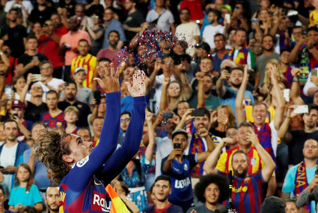 Barcelona's French forward Antoine Griezmann celebrates after scoring a second goal during the Spanish League football match between Barcelona and Real Betis at the Camp Nou stadium in Barcelona on August 25, 2019. (Photo by Albert Gea/Reuters)