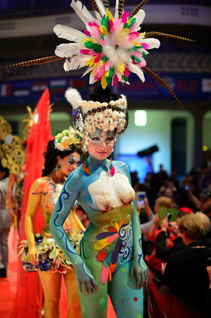 """A model poses on the catwalk after the contest """"Body Painting"""" of the OMC Hairworld World Cup on May 4, 2014 in Frankfurt am Main, Germany. The OMC Hairworld World Cup will be held in Frankfurt from 3 to 5 May 2014, parallel to the Hair and Beauty 2014 fair. Around 1.250 participants from 50 countries fight in different contest for the titles. (Photo by Thomas Lohnes/Getty Images)"""