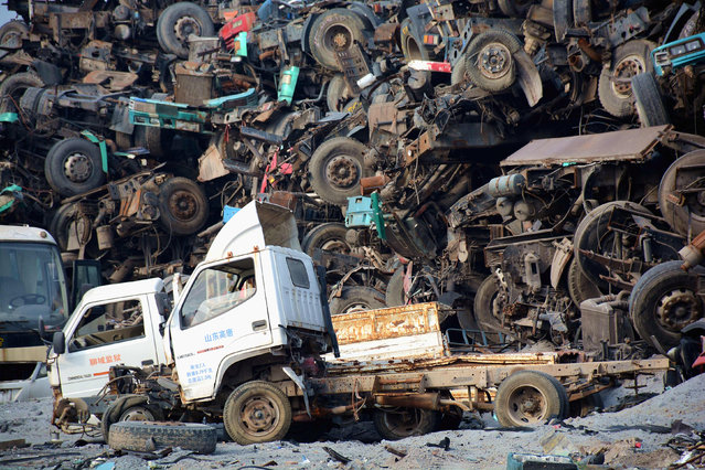 Vehicles and wrecked automobile components are seen at a recycling centre in Liaocheng, Shandong Province, China, May 3, 2016. (Photo by Reuters/Stringer)