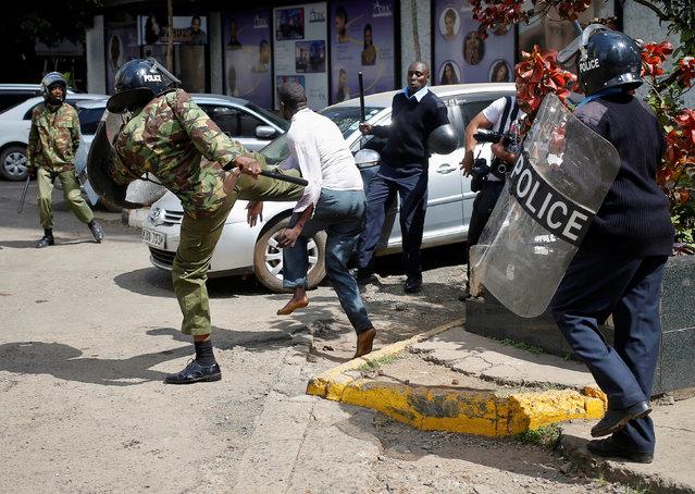Kenyan policemen beat a protester during clashes in Nairobi, Kenya May 16, 2016. (Photo by Goran Tomasevic/Reuters)