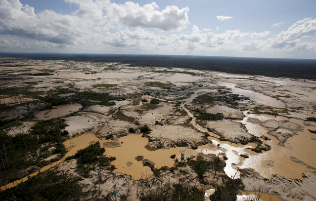 An area deforested by illegal gold mining is seen in a zone known as Mega 14, in the southern Amazon region of Madre de Dios July 14, 2015. (Photo by Janine Costa/Reuters)