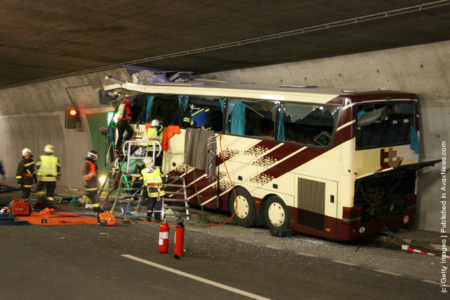 In this handout image provided by the Police of Swiss canton Valais the wreckage of a bus is seen after it crashed inside a motorway tunnel on March 13, 2012 in Sierre, Switzerland