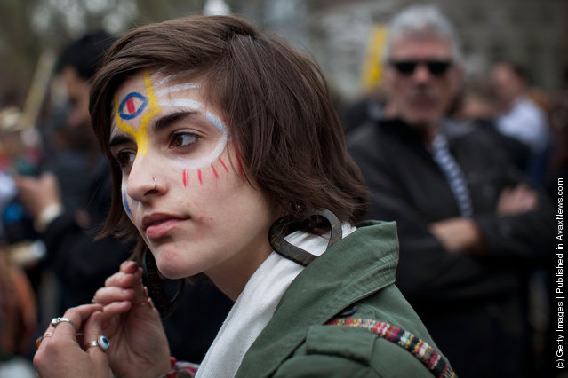 An Occupy Wall Street protester is seen in Union Square at the end of a march from Zuccotti Park to Union Square