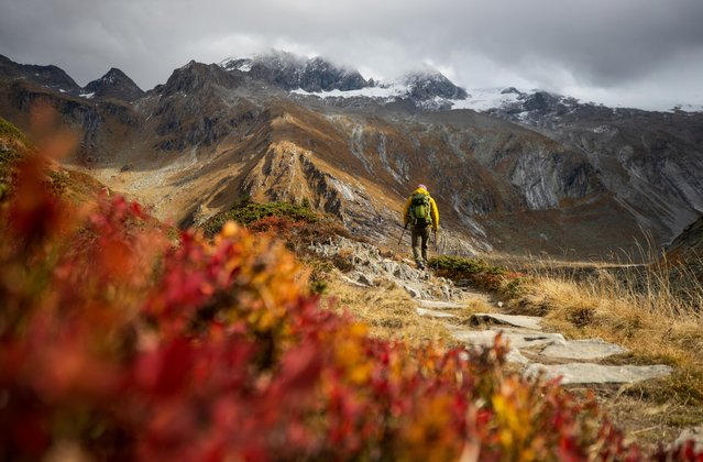 A hiker walks in the Zillertal Alps during an autumn day near the village of Ginzling, Austria, October 15, 2019. (Photo by Lisi Niesner/Reuters)