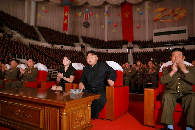 North Korean leader Kim Jong Un (2nd R) and his wife Ri Sol Ju (C), together with service personnel of the Korean People's Army (KPA), watch an art performance given by the State Merited Chorus to mark the 62nd anniversary of the end of the Korean War, in this undated photo released by North Korea's Korean Central News Agency (KCNA) in Pyongyang August 4, 2015. (Photo by Reuters/KCNA)