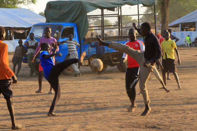 Youth displaced by fighting in South Sudan play soccer on arrival at Bidi Bidi refugee's resettlement camp near the border with South Sudan, in Yumbe district, northern Uganda December 7, 2016. (Photo by James Akena/Reuters)
