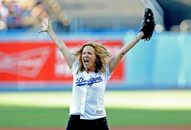 Actress Lea Thompson reacts after throwing out the first pitch before the game between the Cincinnati Reds and the Los Angeles Dodgers at Dodger Stadium on August 15, 2015 in Los Angeles, California, ahead of the after game showing of Back to Future on the stadium video boards. (Photo by Stephen Dunn/Getty Images)