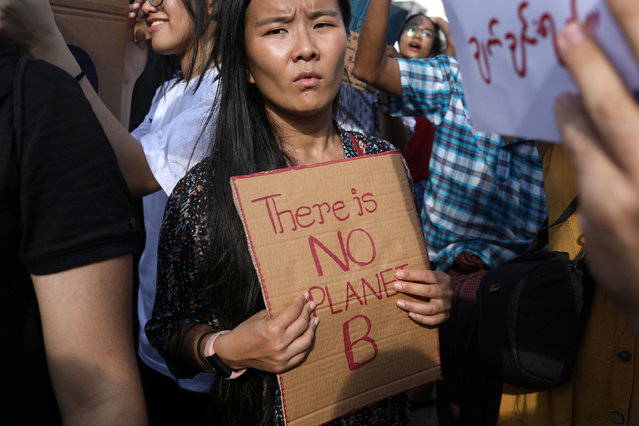Protesters hold placards as they attend a climate change demonstration in Yangon, Myanmar, September 22, 2019. (Photo by Ann Wang/Reuters)