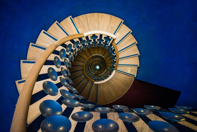 It's enough to make your head spin. The photographer Katherine Young set out to shoot spiral staircases in London, England to great effect, including this shot she calls the Downward Spiral Part III. (Photo by Katherine Young/Rex Features/Shutterstock)