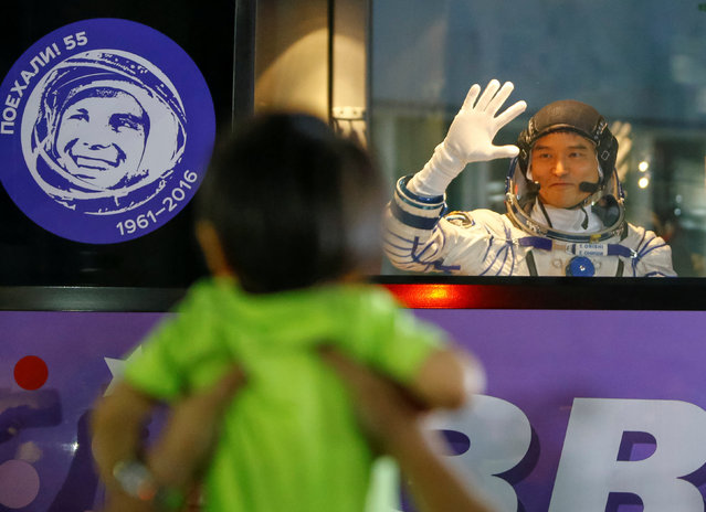 The International Space Station (ISS) crew member Takuya Onishi of Japan waves to his family members from a bus as he leaves to board a spacecraft at the Baikonur cosmodrome, Kazakhstan, July 7, 2016. (Photo by Shamil Zhumatov/Reuters)