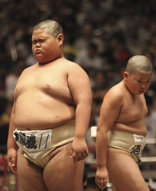An elementary school sumo wrestler reacts after his bout at the National Children's Sumo tournament in Tokyo, Japan on July 30, 2012. (Photo by AP Photo)