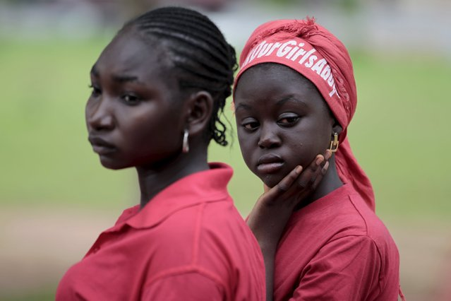 Bring Back Our Girls (BBOG) campaigners look on during a protest procession marking the 500th day since the abduction of girls in Chibok, along a road in Abuja August 27, 2015. The Islamist militant group Boko Haram kidnapped some 270 girls and women from a school in Chibok a year ago. More than 50 eventually escaped, but at least 200 remain in captivity, along with scores of other girls kidnapped before the Chibok girls. (Photo by Afolabi Sotunde/Reuters)