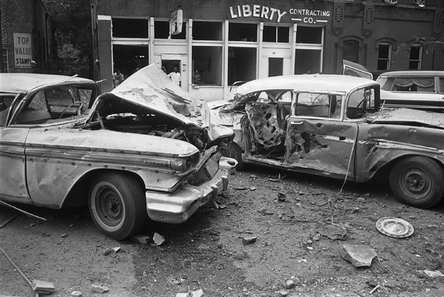 In this September 15, 1963 file photo, damaged automobiles show the force generated by an explosion which tore large pieces of stone from the 16th Street Baptist Church during services in Birmingham, Ala. A bomb planted by Ku Klux Klansmen ripped apart the building and killed four black girls. (Photo by AP Photo)