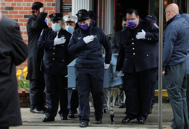 "Members of the New York City paramedic community escort the casket of their colleague as they attend a funeral for New York City paramedic Anthony ""Tony"" Thomas during the outbreak of coronavirus disease (COVID-19) in the Bay Ridge area of Brooklyn, New York, U.S., April 30, 2020. (Photo by Brendan McDermid/Reuters)"