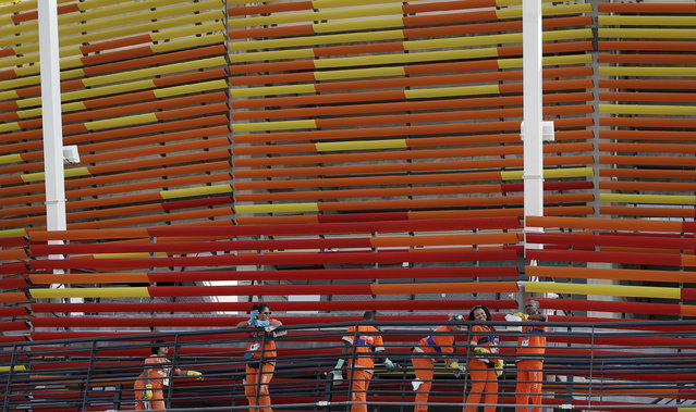 Workers continue to put the finishing touches to the Olympic Tennis Centre at the 2016 Summer Olympics in Rio de Janeiro, Brazil, Thursday, August 4, 2016. (Photo by Ben Curtis/AP Photo)