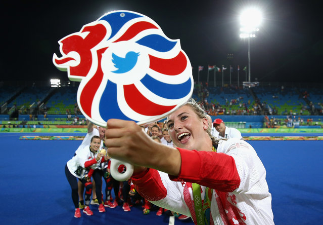 Team Great Britain pose with their gold medals for a selfie taken by Lily Owsley after defeating Netherlands in the Women's Gold Medal Match on Day 14 of the Rio 2016 Olympic Games at the Olympic Hockey Centre on August 19, 2016 in Rio de Janeiro, Brazil. (Photo by David Rogers/Getty Images)