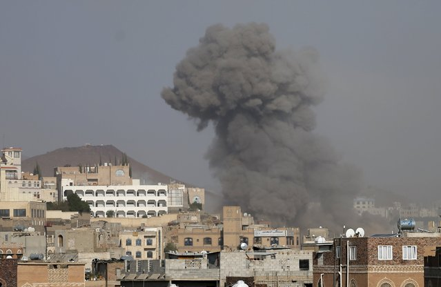 Dust rises from the site of a Saudi-led air strike in Yemen's capital Sanaa September 17, 2015. (Photo by Khaled Abdullah/Reuters)