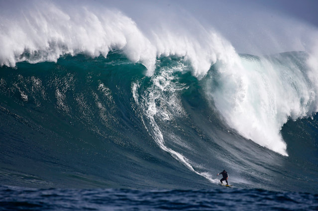 South African surfer Andy Marr rides a wave at Dungeons offshore reef in the Atlantic Ocean outside Cape Town, South Africa, 01 September 2016. The big wave surfing season is at its peak with winter swells driven by storms in the South Atlantic breaking on the Cape's outer reefs providing good conditions. Big wave surfers are competing in the 2016 Striped Horse Challenge and Rebel Sessions big wave competitons symultaneously throughout the season. (Photo by Nic Bothma/EPA)