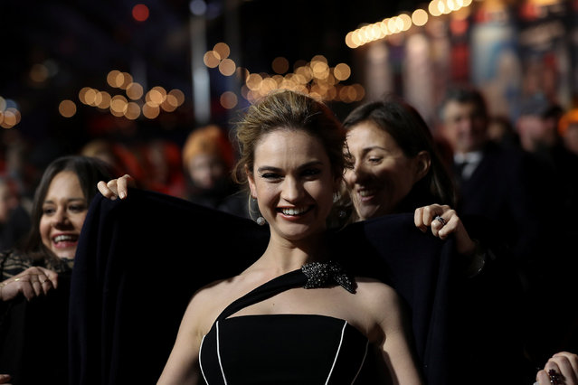 Actor Lily James is given a coat as she arrives at the UK premiere of Darkest Hour in London, Britain December 11, 2017. (Photo by Simon Dawson/Reuters)
