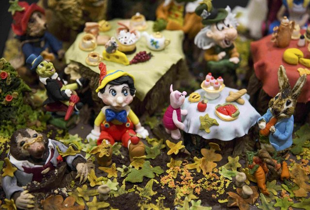 A cake decorated as a variety of children's book characters is displayed at the Cake and Bake show in London, Britain October 3, 2015. (Photo by Neil Hall/Reuters)