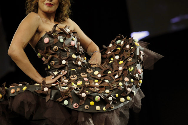 French TV host Severine Ferrer presents a chocolate studded dress during a show as part of the chocolate fair in Paris, Tuesday, October 28, 2014. (Photo by Christophe Ena/AP Photo)