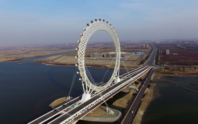 Bailang River Bridge Ferris Wheel is under construction on November 27, 2017 in Weifang, Shandong Province of China. The ferris wheel over Bailang River measures 145 metres tall with 36 carts that can carry 10 passengers each. The wheel is 125 meters in diameter and features a grid design. Constructed by Tianjin Craftsman Manufacture, the wheel is ten metres taller than the world famous London Eye, and boasts Wi-Fi on-board. (Photo by VCG/VCG via Getty Images)