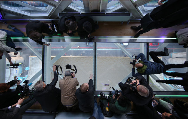 Photographers get a unique view of the River Thames from Tower Bridge's new glass walkway on November 10, 2014 in London, England. (Photo by Peter Macdiarmid/Getty Images)