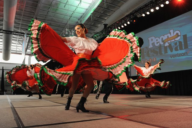Dancers from Calpulli Mexican Dance Company perform at Festival PEOPLE En Espanol 2015 presented by Verizon at Jacob Javitz Center on October 17, 2015 in New York City. (Photo by Brad Barket/Getty Images for PEOPLE En Espanol)
