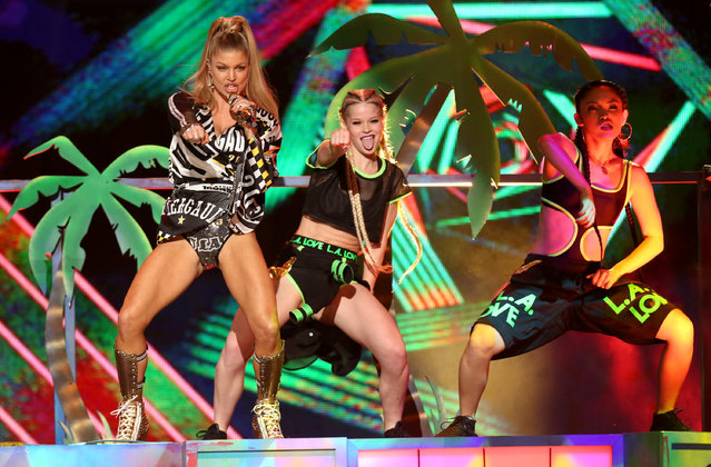Fergie performs at the 42nd annual American Music Awards at Nokia Theatre L.A. Live on Sunday, November 23, 2014, in Los Angeles. (Photo by Matt Sayles/Invision/AP Photo)