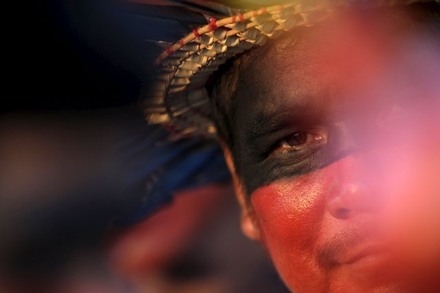 An indigenous man is seen during a presentation of the various sporting disciplines included in the first World Games for Indigenous Peoples in Palmas, Brazil, October 24, 2015. (Photo by Ueslei Marcelino/Reuters)