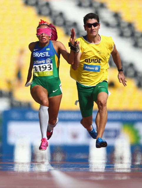 Terezinha Guilhermina of Brazil competes in the women's 100m T11 heats during the Morning Session on Day Six of the IPC Athletics World Championships at Suhaim Bin Hamad Stadium on October 27, 2015 in Doha, Qatar. (Photo by Francois Nel/Getty Images)