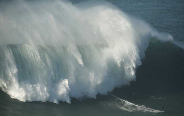 Big-wave surfer Big-wave surfer Kealii Mamala of Hawaii drops in on a large wave at Praia do Norte, in Nazare November 29, 2014. (Photo by Rafael Marchante/Reuters)