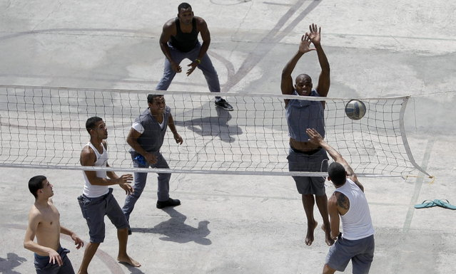 Prisoners play volleyball at the Combinado del Este prison during a media tour in Havana, Cuba, Tuesday, April 9, 2013.  Cuban authorities led foreign journalists through the maximum security prison, the largest in the Caribbean country that houses 3,000 prisoners. Cuba says they have 200 prisons across the country, including five that are maximum security. (Photo by Franklin Reyes/AP Photo)