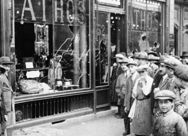 Shop windows were smashed and business places wrecked when Sacco Vanzetti sympathizers became violent here in a post execution demonstration and many were injured in a clash with the police near the American Embassy. This view shows one of the places visited by the rioters on August 31, 1927 in Cherbourg, France. (Photo by AP Photo)