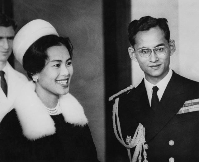 King Bhumibol and Queen Sirikit of Thailand attend a reception at Wellington Town Hall at the start of their eight-day tour of New Zealand, August 1962. (Photo by Central Press/Hulton Archive/Getty Images)