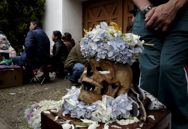 """A skull is pictured during a ceremony held for the """"Dia de las natitas"""" (Day of the Skull) celebrations at the General Cemetery of La Paz, November 8, 2015. (Photo by David Mercado/Reuters)"""