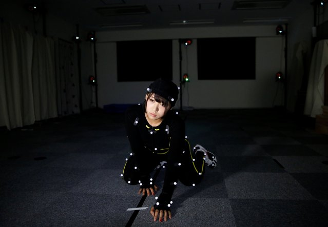 Motion capture actress Yumi Ueno wearing a motion capture suit performs for adult game company Illusion's virtual reality production at a motion capture studio in Tokyo, Japan, July 25, 2017. (Photo by Toru Hanai/Reuters)