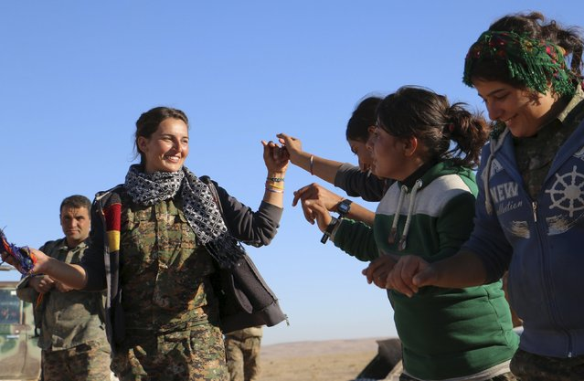 Kurdish female fighters from the People's Protection Units (YPG), who are fighting alongside with the Democratic Forces of Syria, celebrate near the Syrian town of al Houl in Hasaka province, after they took control of the area, November 14, 2015. (Photo by Rodi Said/Reuters)