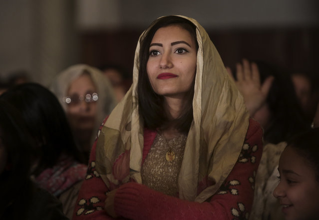 An Egyptian Coptic Christian listens during Christmas Eve Mass at St. Mark's Cathedral, in Cairo, Egypt, Tuesday, January 6, 2015. The Coptic Christian population are considered to be the largest Christian community in the Middle East and observe Christmas on January 7 according to the old, Julian calendar. (Photo by Nariman El-Mofty/AP Photo)