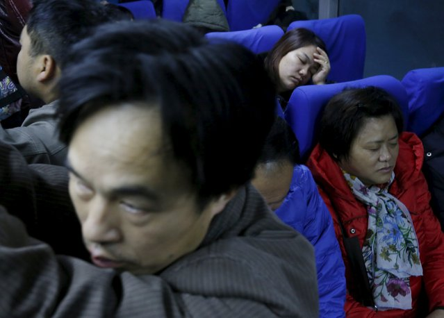 Migrant worker Lai Yongmei, 47, sleeps on a bus on her way into Beijing, China, November 16, 2015. (Photo by Kim Kyung-Hoon/Reuters)